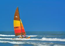 A splash of color. Sail boat going out to sea Royalty Free Stock Image