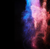 Splash of colored powder Stock Images
