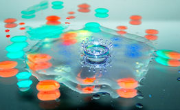 Splash of colors. Splash water drops in drops of paint Royalty Free Stock Photos
