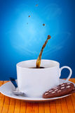 Splash in a cup of coffee Royalty Free Stock Images