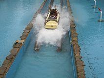 Splash Down. This is a shot of some teenagers getting cooled off on a log flume ride in an amusement park stock images