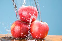 Splash drop on group of apple Royalty Free Stock Images
