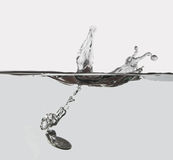 Splash. Of falling coins Royalty Free Stock Photo