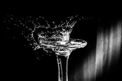 Splash from falling drop on glass in the shape of a crown Stock Photos