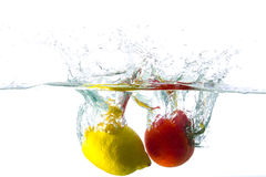 Splash with food. Refreshing meal sprinkled with water Royalty Free Stock Photos
