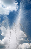 Splash of fountain against the sky Stock Images
