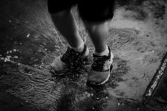 Free Splash From A Child Jumping In A Rain Puddle Stock Photos - 126727133