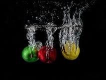 Splash, frozen, still life, falling fruits stock images