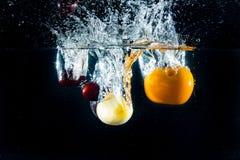 Splash fruit Stock Photos