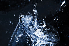 Splash in a glass. Stream  water being poured into a glass. Splash in a glass Stock Photos
