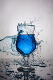 Splash in glass of blue alcoholic cocktail drink Royalty Free Stock Image