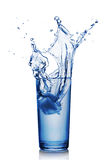 Splash in glass of blue water with ice cube Royalty Free Stock Photography