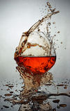 Splash in glass of cognac Royalty Free Stock Photography