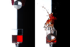 Splash Glass, cristal world falling on red drink Royalty Free Stock Photo
