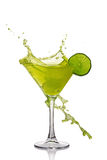 Splash in glass of green alcoholic cocktail drink with lime Stock Photography