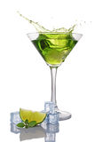 Splash in glass of green alcoholic cocktail drink with lime, mint and ice cube. Isolated on white background royalty free stock photos