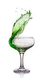 Splash in glass of a green alcoholic cocktail drink Stock Photography