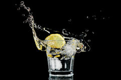Splash in a glass with lemon and ice Stock Photography