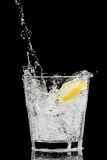 Splash in a glass with lemon and ice Royalty Free Stock Photo