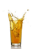 Splash in glass of orange juice with ice Royalty Free Stock Images