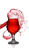 Splash in glass of red alcoholic cocktail drink Royalty Free Stock Image