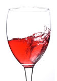 Splash in glass with red wine Stock Image