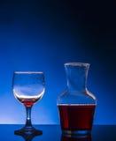 Splash glass red wine. Blue background Royalty Free Stock Photo
