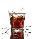 Splash in glass of scotch whiskey with ice cubes Royalty Free Stock Photos