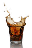 Splash in glass of scotch whiskey with ice Stock Photos