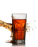 Splash in glass of scotch whiskey royalty free stock images