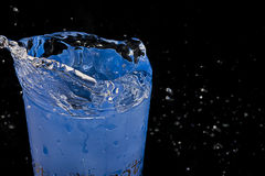 SPLASH ON A GLASS OF WATER Royalty Free Stock Images