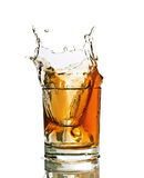 Splash in a glass of whiskey. Studio shot, white background Stock Photo