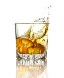 Splash in glass of whiskey and ice  Stock Photo