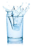 Splash from ice cube in a glass of water. Splash from ice cube in a glass of water, isolated on the white background, clipping path included Stock Photography