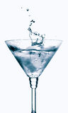 Splash from ice cube in martini glass Stock Images
