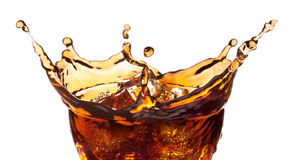 Splash from ice cubes in a glass of cola. Royalty Free Stock Image