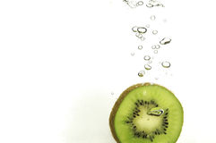Splash kiwi slice Stock Photos