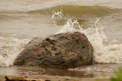 Splash on Large Rock Stock Photos