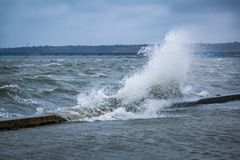 Splash of a large wave on the flooded embankment of the resort city on the Black Sea.  royalty free stock photo