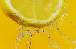 Splash and lemon. Stock Photo