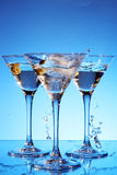 Splash martini on blue Stock Images