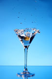 Splash martini on blue Stock Photography