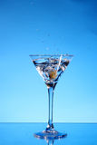 Splash martini on blue Royalty Free Stock Photo