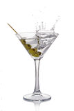 Splash in martini glass of white transparent alcoholic cocktail drink with olive Royalty Free Stock Image