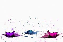 Splash. Multicolored paint splash on white background Stock Photo