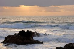 Splash of ocean waves sunset Royalty Free Stock Photo