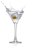 Splash from olive in a glass of cocktail. Royalty Free Stock Images