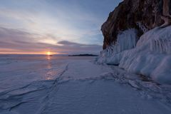 The icy splashes on the rock at dawn light. Splash out ice on the rock at dawn light, winter lake Baikal, cape Oltrec Royalty Free Stock Photos