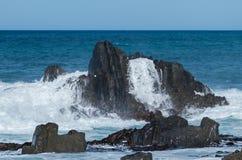 Splash Over Rocks Royalty Free Stock Photos
