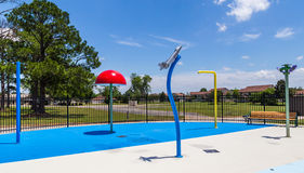 Splash Pad On Air Force Base. Small splash pad on an Air Force Base for resident kids to cool off during the Summer Stock Photo